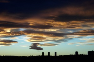 Lenticular clouds, like these ones, can appear dramatic and can indicate that a weather front is coming.