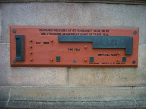 This cast iron plaque on Glasgow City Chambers provides a reference for how long a foot is. In the event of the end of civilisation, it will survive long after all the knowledge on all the computer servers in the world has disappeared.